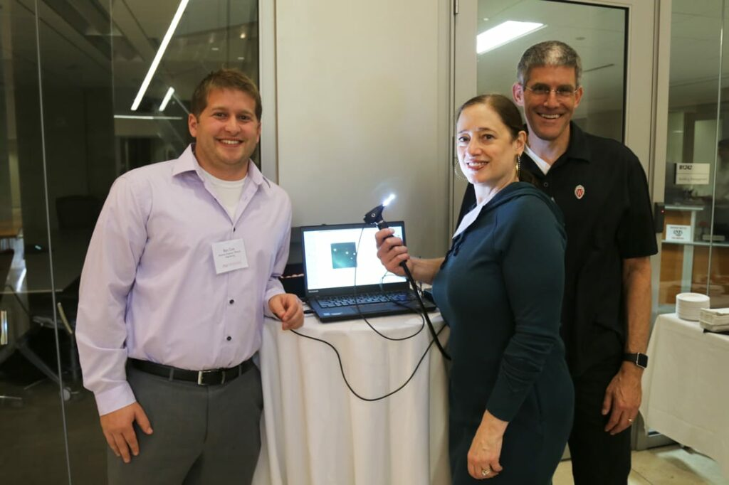 Ben Cox (left) of the Morgridge Medical Engineering team, with Karen Walsh and James Berbee, helped develop the initial prototype of the new otoscope.