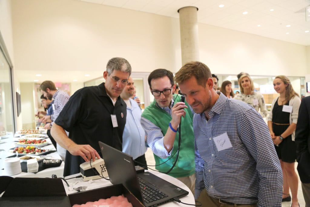Dr. James Berbee with Dr. Mike Steuerwald and Dr. Chris Stahmer of UW Emergency Medicine test out the newly developed otoscope device.