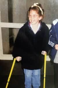 Courtni (9) with her first crutches in recovery.