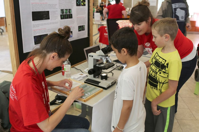Ellen Arena (right) and Kristy Wendt demonstrate a microscopy activity during a Science Expeditions event at the Discovery Building.
