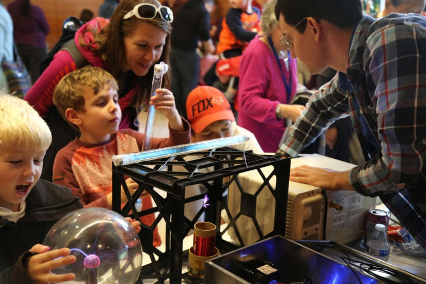 A family learns about plasma science from physicists at the Wisconsin Science Festival's Discovery Expo. The Discovery Expo is a hands-on, family-friendly event that takes place in the Discovery Building over all four days of the festival.