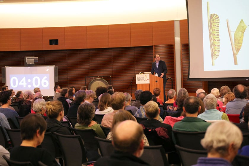 "Josh Coon, a UW-Madison chemistry professor, gives a flash talk on his work as the clock ticks down during the 2016 ""Big Ideas for Busy People"" event. The 2017 festival will host ""Big Ideas for Busy People: Big Data Edition"" on Saturday, Nov. 4."
