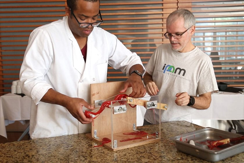 """Jean-Luc Thiffeault (right), a UW-Madison professor of mathematics, will discuss the math of taffy pulling at """"Mathy Taffy"""" on Sunday, Nov. 5 at the  Discovery Building. In collaboration with Steenbock's on Orchard, a taffy-making demonstration will accompany the presentation."""