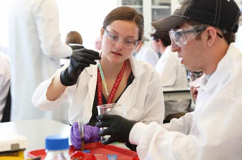 Two students prepare glitter